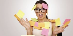 a lady with post-it notes all over her