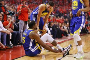 kevin durant talking to klay thompson as he grabs his heel in game 5 of the 2019 nba finals
