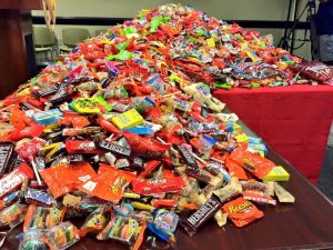 halloween candy spread out on a table