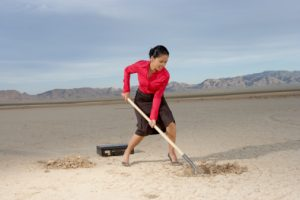businesswoman digging a hole