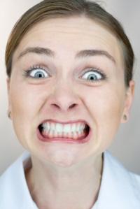 lady grinding her teeth