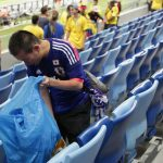 considerate world cup fans from japan, senegal & uruguay pick up trash