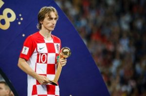 luka modric with his golden ball trophy