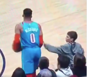 nuggets fan touches russ