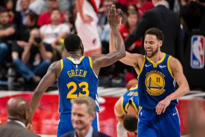 klay thompson high fives draymond green after the golden state warriors sweep the portland trailblazers in the 2019 nba western conference finals